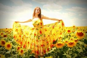 girl in a yellow dress against the backdrop of sunflowers