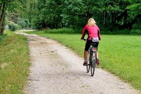 cycling female on a cycle path