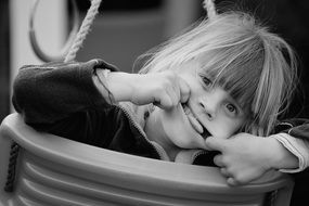 child girl blond face swing black and white recording