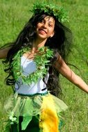 young girl with long ,black hair is dancing