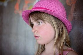 The look of a girl in a pink hat