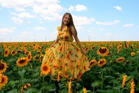 girl in a yellow dress with a pattern of the sunflowers