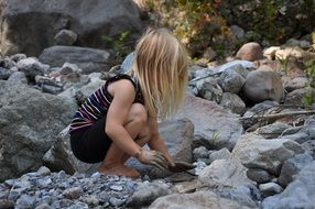 child girl play bach water stones