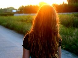 bright sunset over a girl with long hair