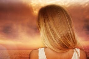 blond long hair girl back view seascape