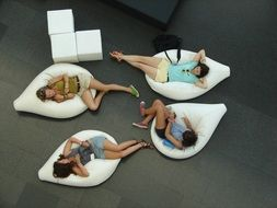 people relaxing on white bag furniture indoor