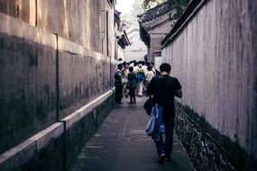 people walking on narrow street, china, beijing