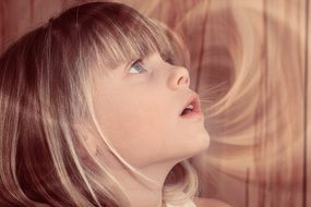 portrait of child girl blond hair amazed view face