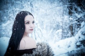 glamour woman in the winter forest