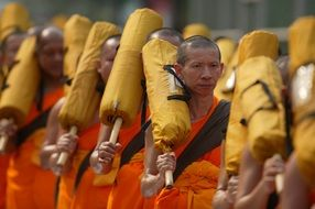 Buddhist monks in orange robes in thailand