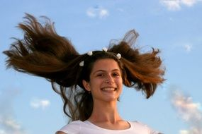 Portrait of jumping girl with long hair