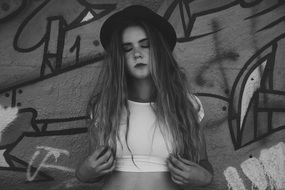 black and white photo of a beautiful girl in a hat