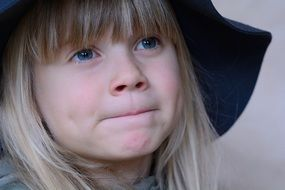 child girl blond hair face big hat