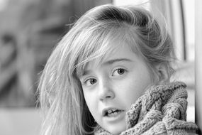 Amazed girl face black and white view