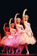 young ballerinas on stage in pink dresses