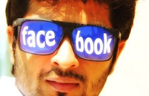 social media icon on a man's sunglasses
