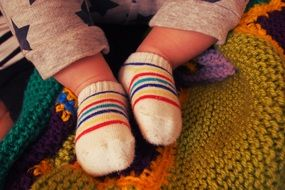 baby feet in striped socks