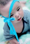 little boy with a blue bow