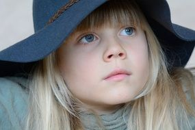 Blue eyes girl blond face hat look