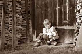 Little girl with teddy bear ground sit wooden wall
