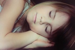 Sleeping pretty girl face blond