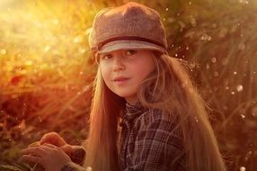 girl with long hair and a hat