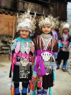two child girls in costumes of unique ethnic minority, china, guizhou