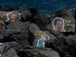 image of musicians on stones on the ocean on Tenerife
