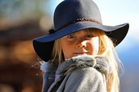 child girl blond hair cute face hat