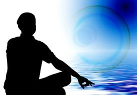 silhouette of a meditator