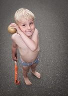 naked baby plays hockey in summer
