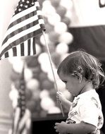 Child is holding the American flag