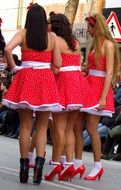 young girls in red dresses outdoor, spain, catalonia