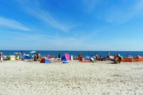 people relax on the beach of the Baltic Sea