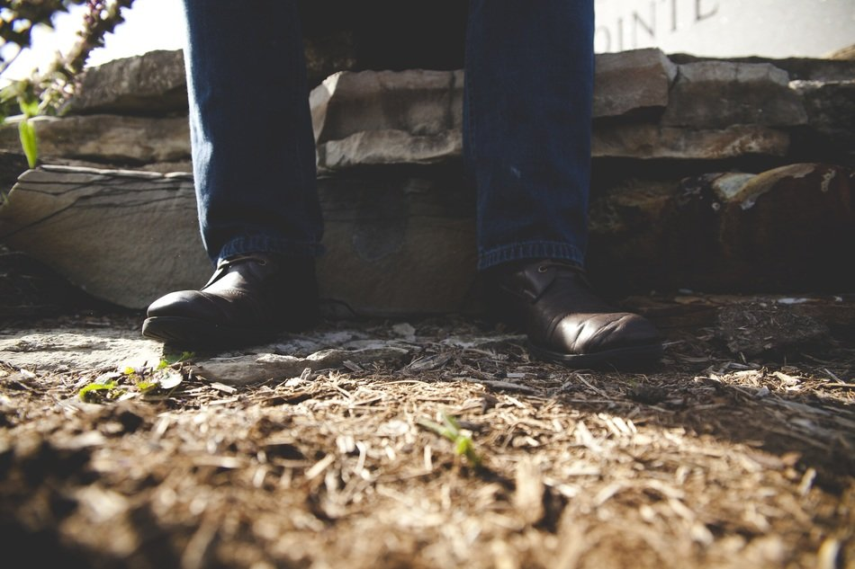 man feet in jeans and shoes