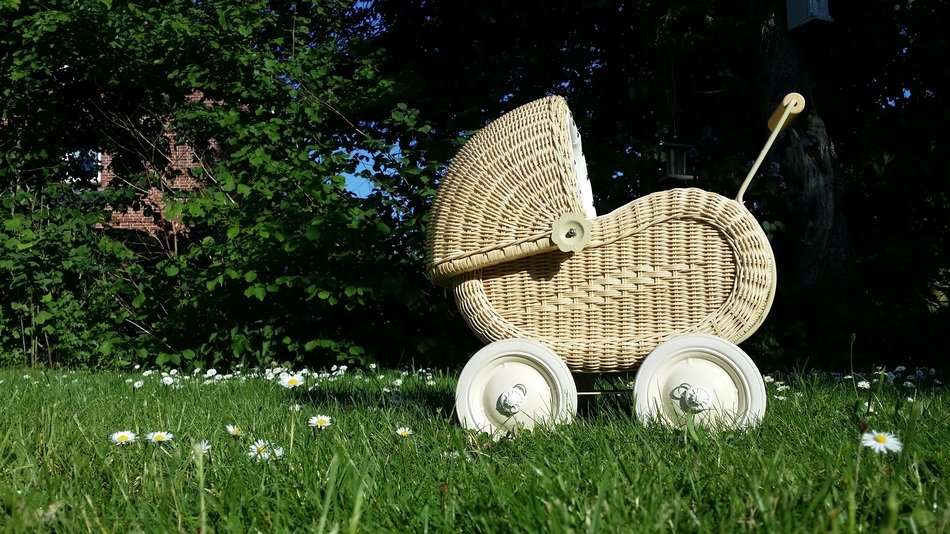 White baby carriage on a grass