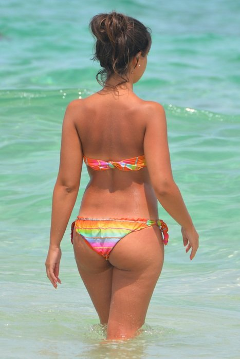 Rear view of a woman in a bikini in the water