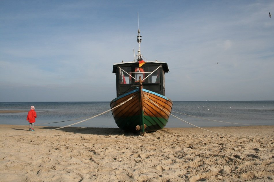 fishing boat on a sandy beach