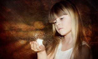 child with a magic in her hand
