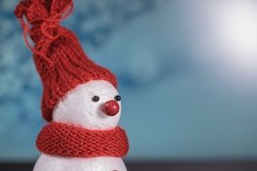 snow man in red winter clothes