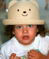 cute baby girl in straw hat