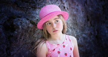 child in a pink hat