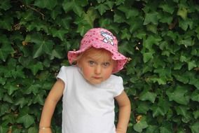 little girl in summer hat with hello kitty