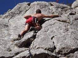 alpinism, man climbing rock
