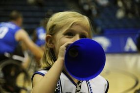 little cheerleader girl at a basketball game