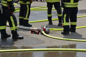 firefighters among the equipment