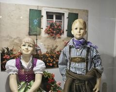 window decorations with children in costumes