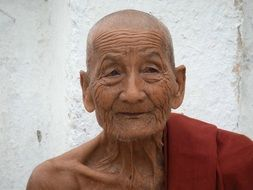 a wise face of the elderly monk