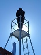 person on lookout tower, silhouette
