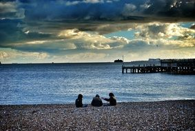 people relax on the beach with stones
